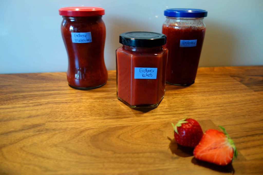 Three Different Kinds Of Jam With Strawberries
